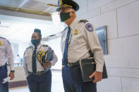 U.S. Capitol Police Chief Thomas Manger, joined at left by Assistant Chief Yogananda Pittman, heads to a closed-door meeting with congressional leaders for a briefing as security officials prepare for a Sept. 18 demonstration by supporters of the people arrested in the Jan. 6 riot, at the Capitol in Washington, Monday, Sept. 13, 2021. (AP Photo/J. Scott Applewhite)