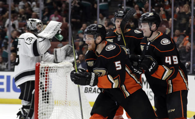 Anaheim Ducks' Korbinian Holzer (5) celebrates his goal with teammates during the second period of an NHL hockey game against the Los Angeles Kings on Friday, April 5, 2019, in Anaheim, Calif. (AP Photo/Marcio Jose Sanchez)