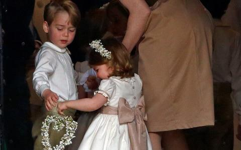 Prince George and Princess Charlotte at the wedding of Pippa Middleton - Credit: Max Mumby/Getty