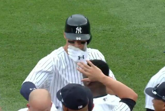 Aaron Judge protected his teeth at all costs during the Yankees walk-off celebration on Saturday. (MLB.TV)