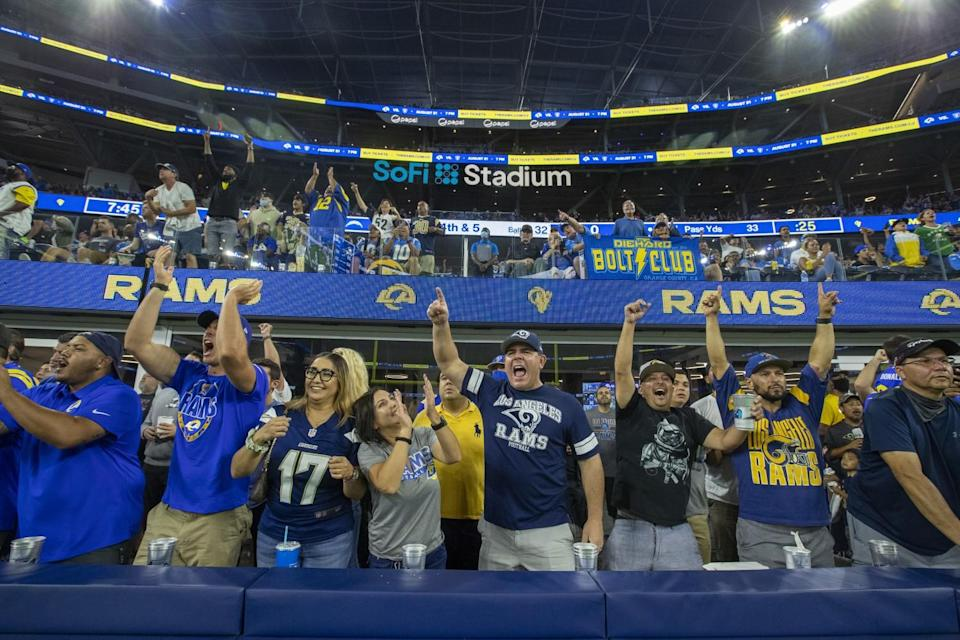 Fans cheer in the stands during the Chargers-Rams preseason game Saturday at SoFi Stadium.