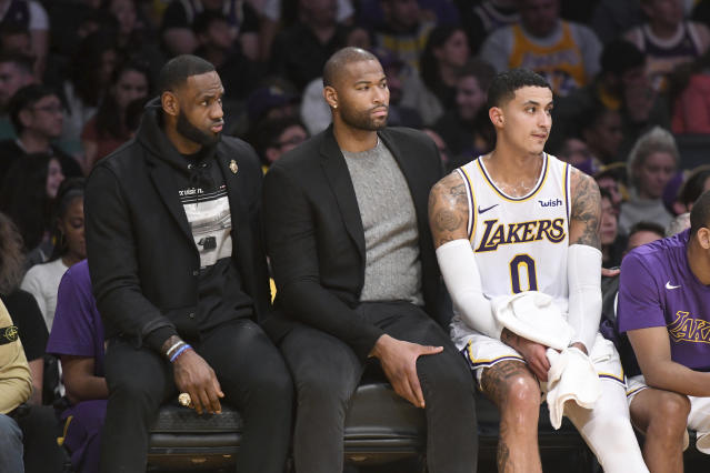 DeMarcus Cousins is done with the Lakers after never playing a game in purple in gold. (AP Photo/Michael Owen Baker)