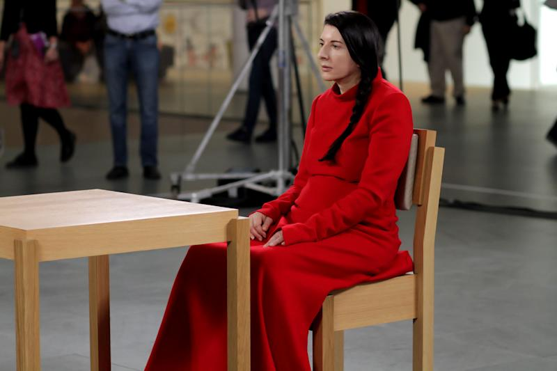 "In this 2010 photo released by Rio Film Festival, performance artist Marina Abramovic sits during the making of documentary film ""Marina Abramovic:The Artist is Present"" in New York's Museum of Modern Art. The Belgrade-born artist is best known for this piece which in 2010 saw her sit silent and motionless for 736.5 hours opposite a parade of strangers. The film is playing at the 2012 Rio de Janeiro International Film Festival. (AP Photo/Rio Film Festival)"