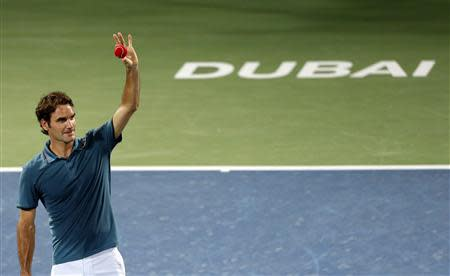 Roger Federer celebrates after defeating Novak Djokovic in their men's singles semi-final match at the ATP Dubai Tennis Championships