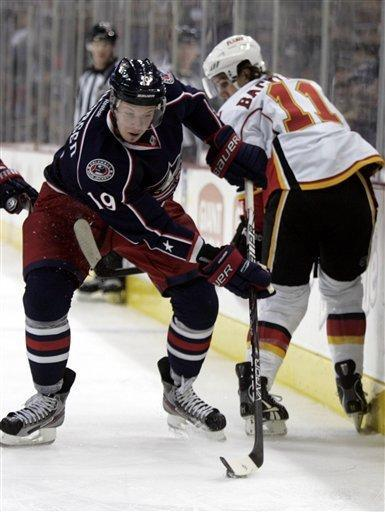 Columbus Blue Jackets' Ryan Johansen, left, works for the puck against Calgary Flames' Mikael Backlund of Sweden in the first period of an NHL hockey game in Columbus, Ohio, Tuesday, Dec. 27, 2011. (AP Photo/Paul Vernon)