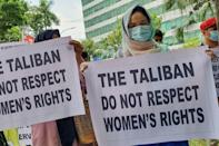 Afghan women at a protest in Indonesia (AFP/AHMAD RIDWAN NASUTION)