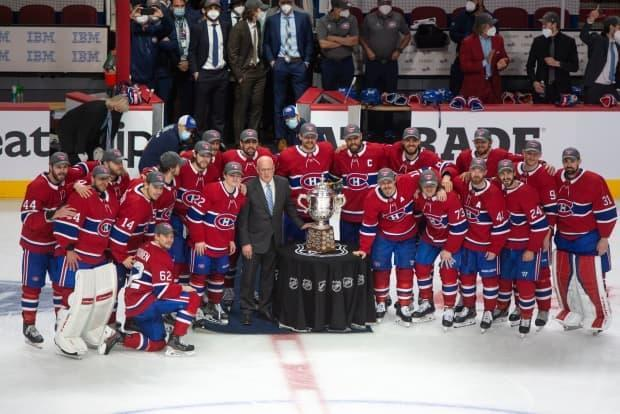Montreal Canadiens players pose with the Clarence S. Campbell trophy on Thursday after defeating the Vegas Golden Knights to advance to the Stanley Cup final. (Ryan Remiorz/The Canadian Press - image credit)