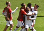 England's Raheem Sterling, centre, is congratulated by teammates after scoring his team's first goal during the Euro 2020 soccer championship group D match between England and Croatia at Wembley stadium in London, Sunday, June 13, 2021. (AP Photo/Justin Tallis, Pool)