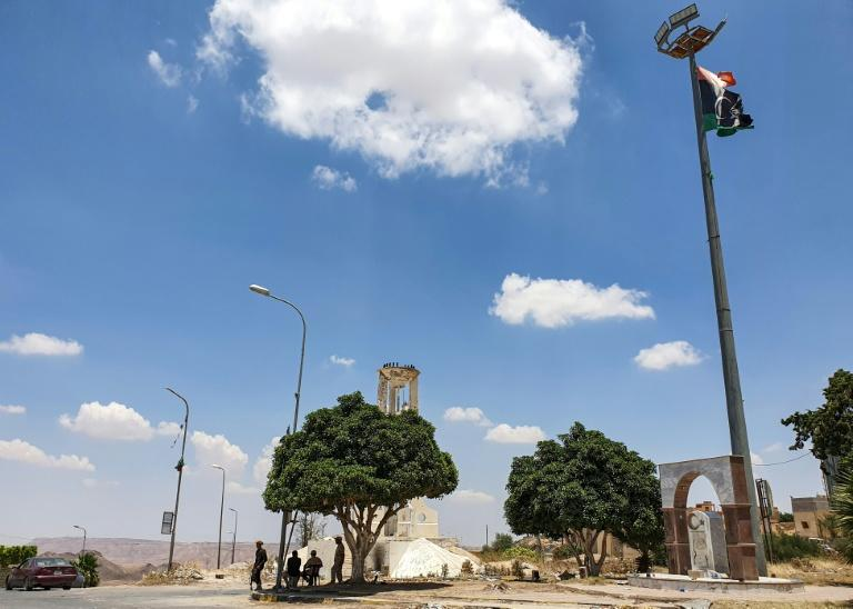 The Libyan national flag flies from a lamp post in Gharyan, 100 kilometres (60 miles) southwest of the capital, after it was retaken by forces loyal to the Tripoli-based Government of National Accord (AFP Photo/Mahmud TURKIA)