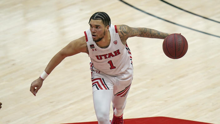Utah forward Timmy Allen (1) brings the ball up court in the second half of a college basketball game against Arizona State on March 6. (AP)