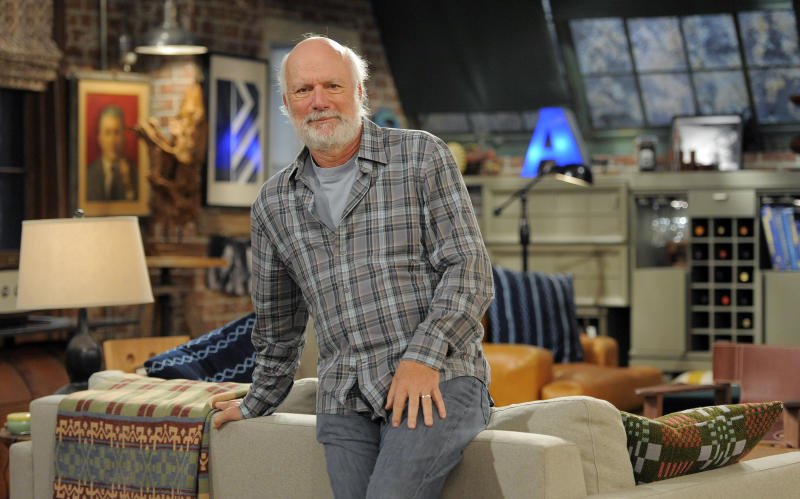 """James Burrows, director of the television series """"Partners,"""" poses for a portrait on the set of the show on Wednesday, Sept. 19, 2012, at Warner Bros. Studios in Burbank, Calif. Burrows isn't a household name. But behind the scenes Burrows reigns as a comedy giant. He's a director whose brand of funny business has helped shape TV comedy season after season. (Photo by Chris Pizzello/Invision/AP)"""