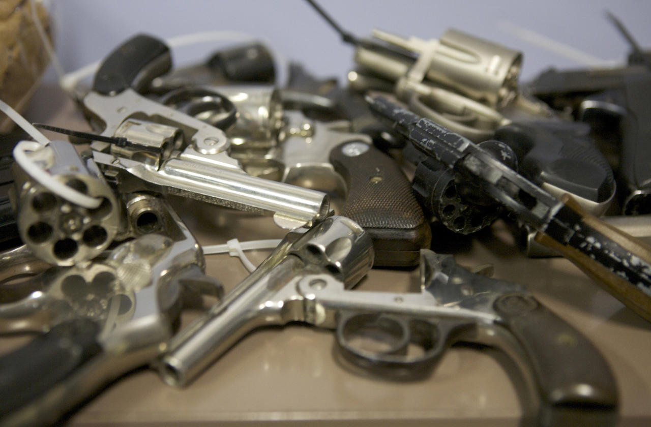 Assorted hand guns turned in during a gun buyback event are seen at the Bridgeport Police Department's Community Services Division in Bridgeport, Connecticut, in the wake of the shootings at Sandy Hook Elementary School, December 22, 2012. REUTERS/ Michelle McLoughlin (UNITED STATES - Tags: SOCIETY)