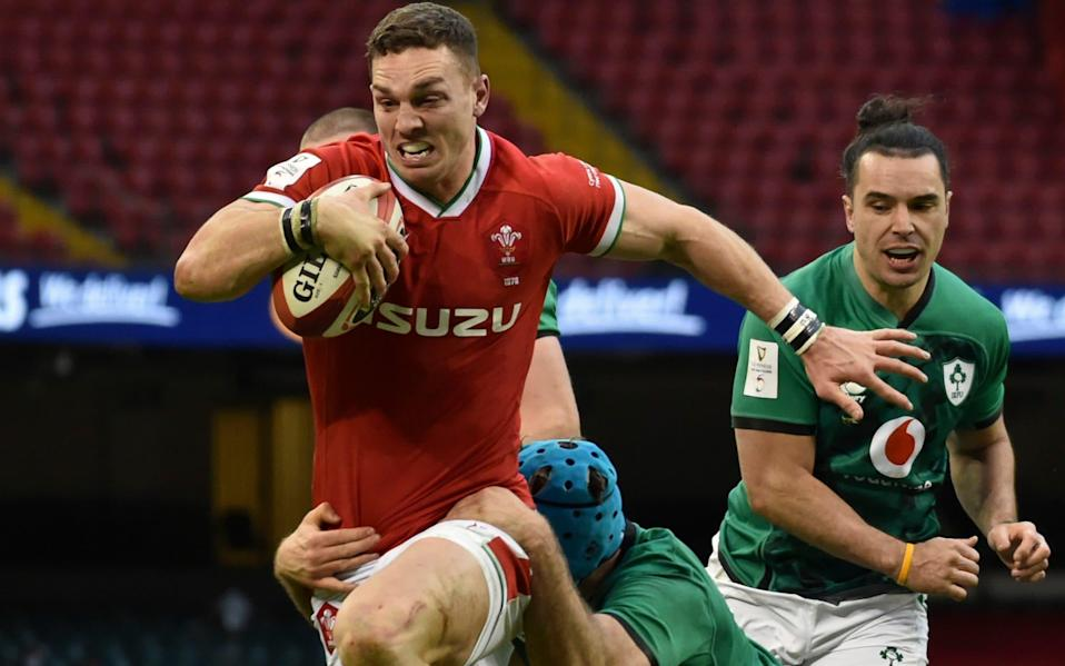 George North bursts through for his try - AP