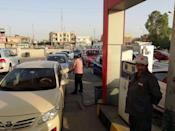 Iraqis queue outside a petrol station in Kirkuk on October 13, 2017, amidst mounting tension between Kurds and the federal government in Baghdad