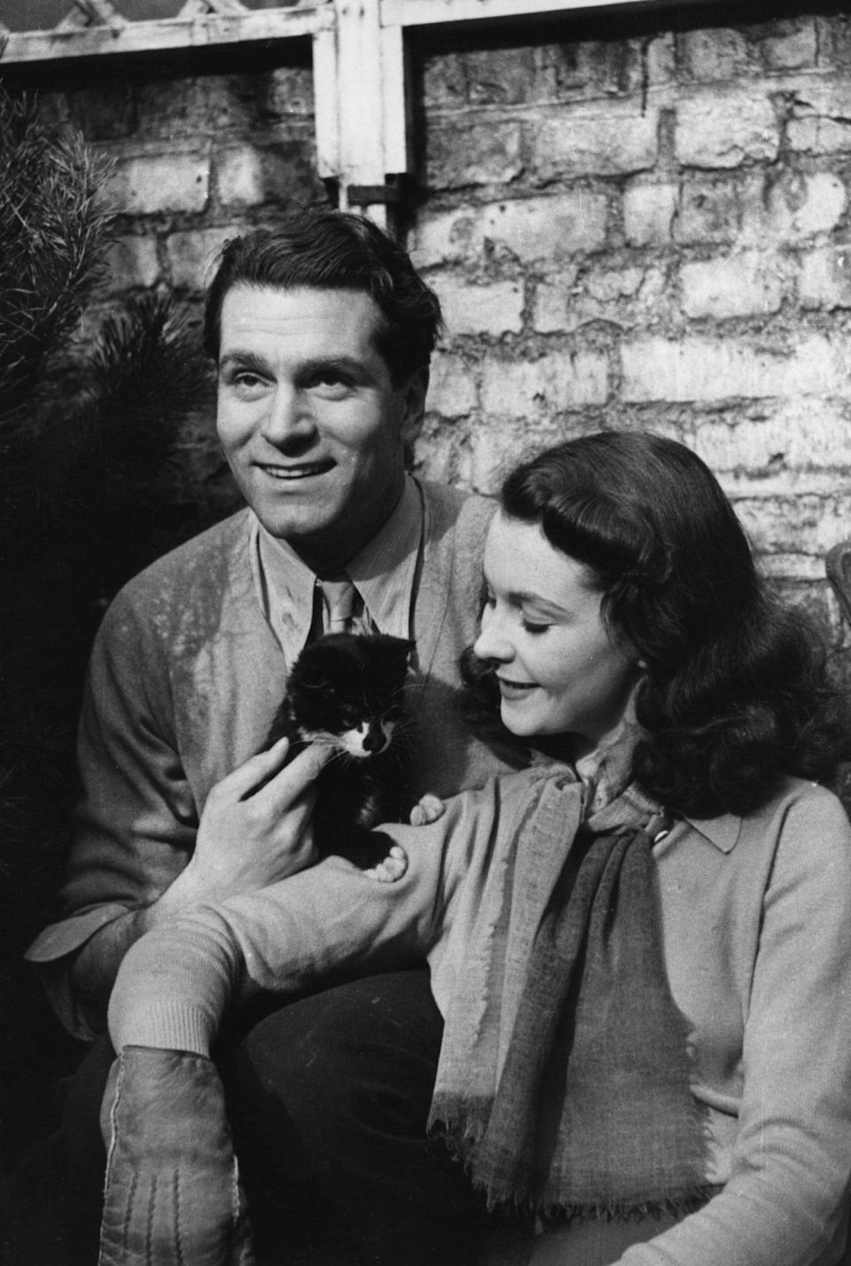 """<p>Leigh brought her fair share of scandal to set. The married (yep!) mother and actress was in the thick of an indiscreet love affair with Laurence Olivier, who was also married at the time. Following divorces from their spouses, <a rel=""""nofollow noopener"""" href=""""https://en.wikipedia.org/wiki/Vivien_Leigh#Marriage_and_early_joint_projects"""" target=""""_blank"""" data-ylk=""""slk:the two wed in 1940"""" class=""""link rapid-noclick-resp"""">the two wed in 1940</a>, a year after <em>Gone with the Wind</em> premiered. Katharine Hepburn was one of the four people to attend the small Santa Barbara, California ceremony.</p>"""