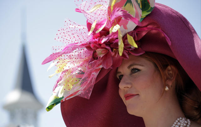 Carrie Cooke Ketterman of Louisville, Ky., looks around the paddock before the 140th running of the Kentucky Derby horse race at Churchill Downs Saturday, May 3, 2014, in Louisville, Ky. (AP Photo/David J. Phillip)