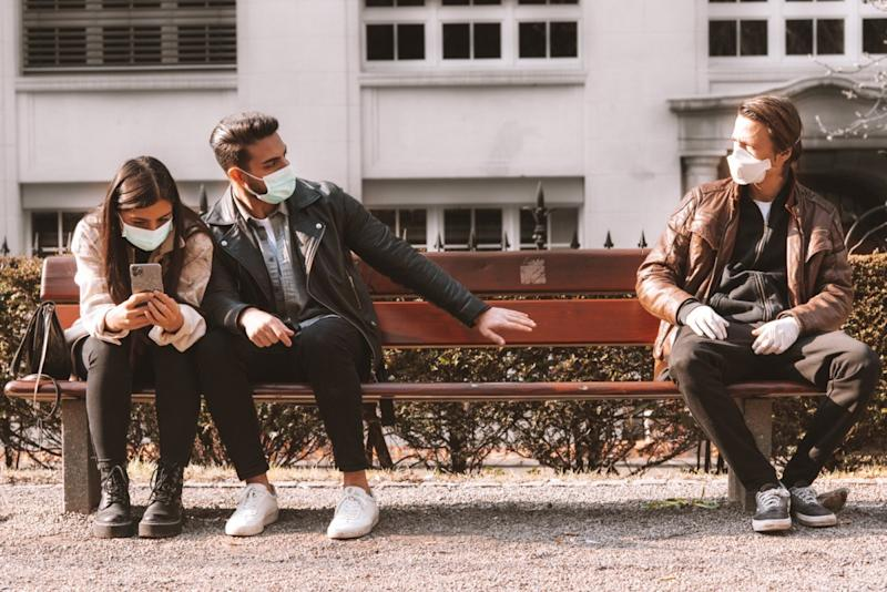 three people wearing face masks - stay away