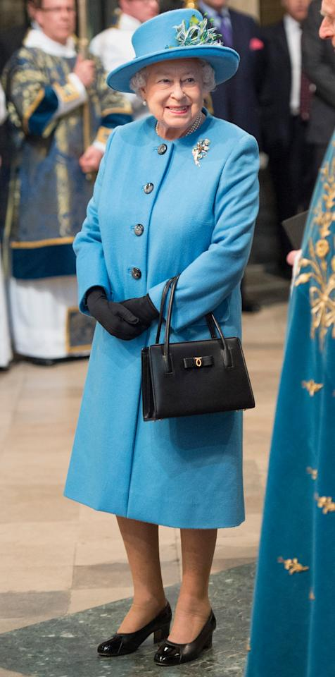<p>Queen Elizabeth II wore a sky blue coat and matching feathered hat at the annual Commonwealth Day service, the largest annual interfaith gathering in the U.K.</p>