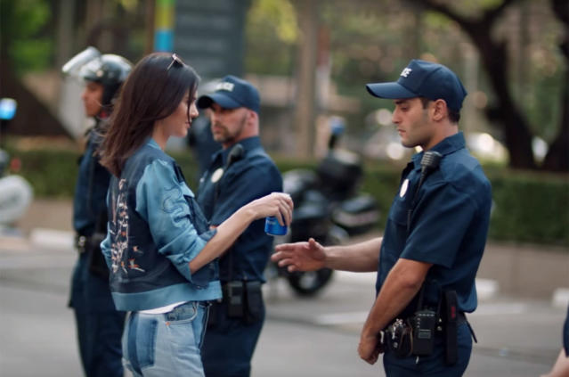 "<p>Speaking of Kendall, the backlash against the model's ""<a href=""https://www.yahoo.com/entertainment/kendall-jenner-said-pepsi-commercial-concept-pre-backlash-014444106.html"" data-ylk=""slk:tone deaf;outcm:mb_qualified_link;_E:mb_qualified_link"" class=""link rapid-noclick-resp newsroom-embed-article"">tone deaf</a>"" Pepsi ad in April was immediate, with many calling out the reality star and the soda company for trivializing the Black Lives Matter movement. Borrowing imagery from the movement, the ad featured Jenner participating in a photo shoot when a protest started nearby. Encouraged by one of the marchers, Jenner joined the crowd and brought peace by going up to one of the police officers and handing him a can of Pepsi, miraculously solving everything. Pepsi ended up pulling the mocked and insensitive ad, apologizing and saying they had ""missed the mark."" The company also apologized to Jenner, who was said to be devastated by the whole thing. (Photo: YouTube/Pepsi) </p>"