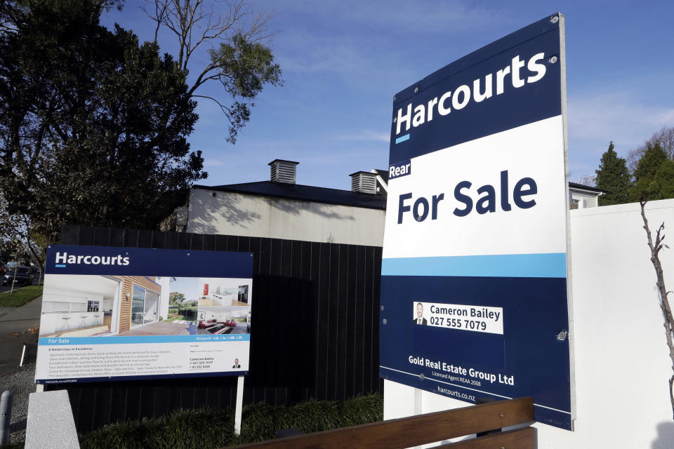 FILE - In this Aug. 13, 2018, file photo, a house is pictured for sale in Christchurch, New Zealand. New Zealand will spend billions of dollars to encourage more home building and will also remove some tax breaks for speculators as it tries to slow skyrocketing house prices. The government on Tuesday, March 23, 2021, announced a series of new measures to address what Prime Minister Jacinda Ardern is describing as a crisis. (AP Photo/Mark Baker, File)