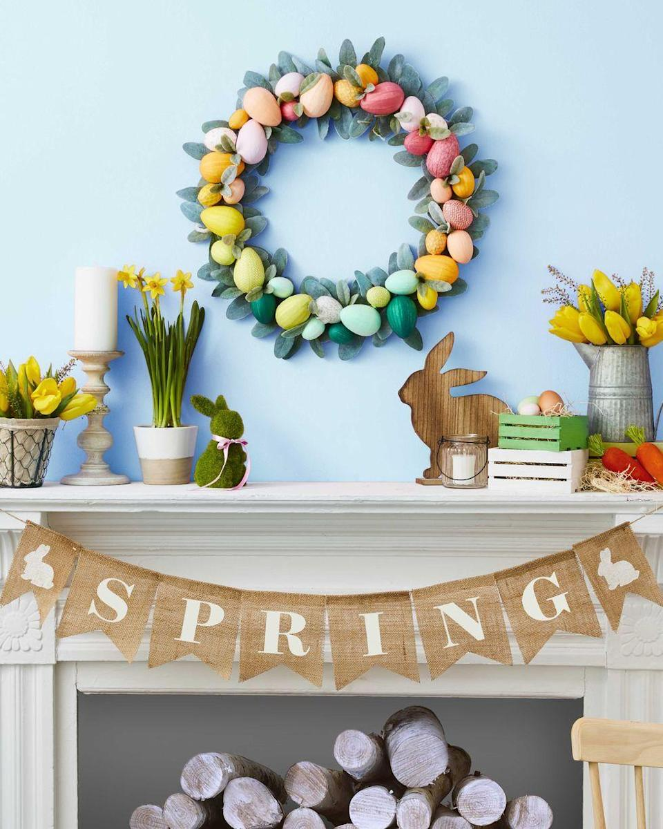 """<p>Here's a fabulous idea to spruce up the typical Easter wreath: just add eggs! It's sure to make anyone's day.</p><p><strong>Make the wreath: </strong>Cut 1/4"""" and 3/8"""" thick strips of colorful tissue paper. Use glue stick to adhere thinner strips to smaller Styrofoam eggs and thicker strips to larger eggs. Wrap tissue paper around egg lengthwise, then apply second strip horizontally. Continue attaching until the egg is completely covered. Arrange faux leaves and eggs around wreath form and hot glue into place. Secure eggs to each other with hot glue where necessary. Once assembled, hot glue a few more sprigs in between eggs for an extra plush look.</p><p><a class=""""link rapid-noclick-resp"""" href=""""https://www.amazon.com/Elmers-Re-Stick-School-Sticks-0-28-Ounces/dp/B01MU4TC7M?tag=syn-yahoo-20&ascsubtag=%5Bartid%7C10050.g.4088%5Bsrc%7Cyahoo-us"""" rel=""""nofollow noopener"""" target=""""_blank"""" data-ylk=""""slk:SHOP GLUE STICKS"""">SHOP GLUE STICKS</a></p>"""