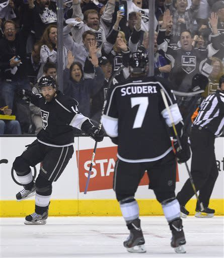 Los Angeles Kings right wing Justin Williams (14) celebrates in front of defenseman Rob Scuderi (7) after scoring a goal against the Chicago Blackhawks during the first period in Game 3 of the NHL hockey Stanley Cup playoffs Western Conference finals, Tuesday, June 4, 2013, in Los Angeles. (AP Photo/Mark J. Terrill)