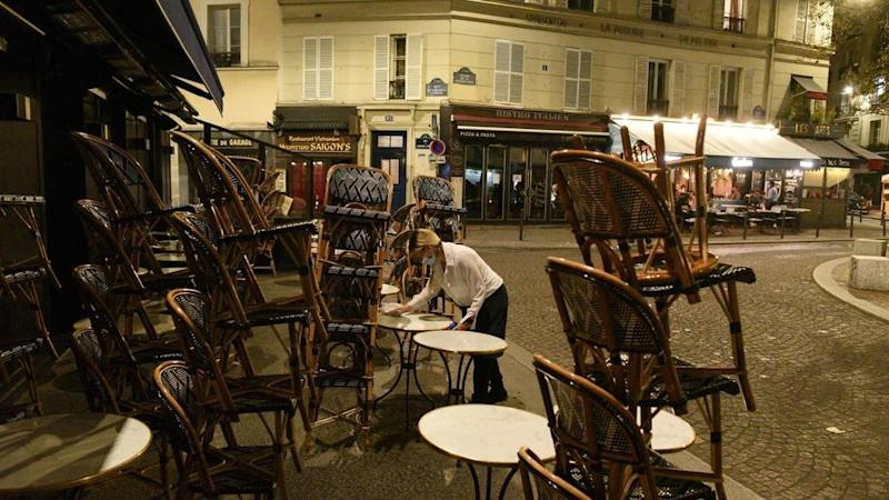 Parisians enjoy last night out before Covid-19 curfew comes into force