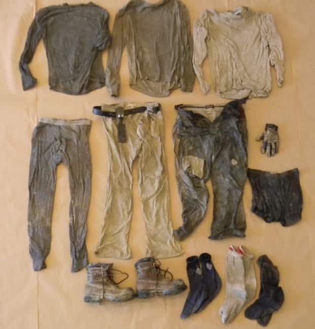 The deceased man was found wearing three long-sleeve shirts, three layers of pants, undergarments, socks, work boots, and a glove.