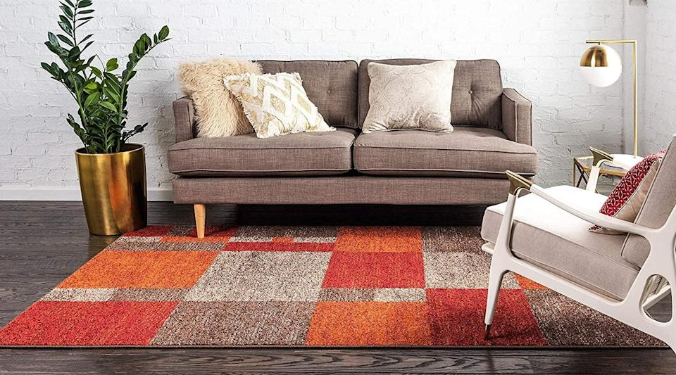 <p><span>Unique Loom Warm Toned Multi Area Rug</span> ($46, originally $158)</p>