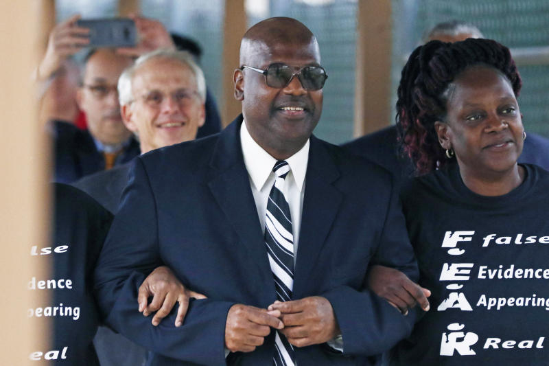 Curtis Flowers flanked by sister Priscilla Ward, right, exits the Winston Choctaw Regional Correctional Facility in Louisville, Miss., Monday, Dec. 16, 2019. Flowers' murder conviction was overturned by the U.S. Supreme Court for racial bias, and he was granted bond by a circuit judge and is free, with some conditions, for the first time in 22 years. (AP Photo/Rogelio V. Solis)