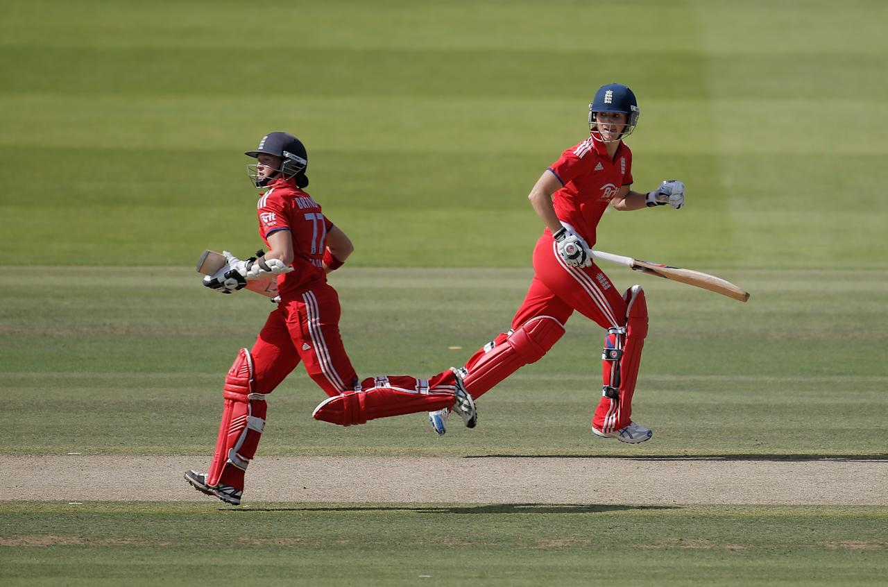 LONDON, ENGLAND - AUGUST 20: Charlotte Edwards (R) and Arran Brindle of England run between the wickets during the first NatWest One Day International match between England and Australia at Lord's Cricket Ground on August 20, 2013 in London, England.  (Photo by Harry Engels/Getty Images)