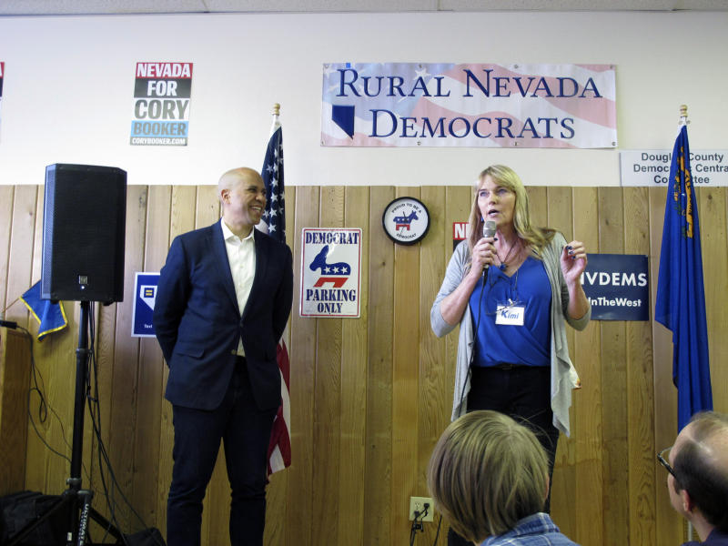 Kimi Cole, right, chairwoman of the Rural Nevada Democratic Caucus, introduces Sen. Cory Booker, D-N.J., on Friday, April 19, 2019, at the Douglas County Democratic headquarters in Minden, Nev.. Booker became the first Democrat running for president in 2020 to make a campaign stop in a rural part of the early caucus state. (AP Photo/Scott Sonner)