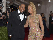 """FILE - In this May 4, 2015, file photo, Jay Z, left, and Beyonce arrive at The Metropolitan Museum of Art's Costume Institute benefit gala celebrating """"China: Through the Looking Glass"""" in New York. Beyonce was nominated for nine Grammy Awards on Tuesday. She is tied with Paul McCartney for the second-most nominated act in the history of the awards show with 79 nominations. Her husband Jay-Z and Quincy Jones, who have both earned 80 nominations each, are tied for first place. (Photo by Evan Agostini/Invision/AP, File)"""