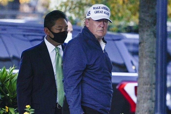 President Trump arrives at the White House after golfing Saturday.