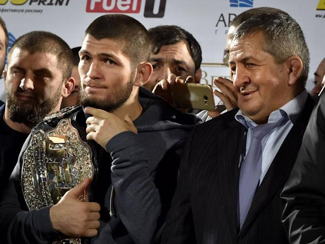 Abdulmanap Nurmagomedov (right) promised 'much stronger' punishment for his son (AFP/Getty)