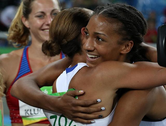 2016 Rio Olympics - Athletics - Final - Women's Heptathlon 800m - Olympic Stadium - Rio de Janeiro, Brazil - 13/08/2016. Gold medallist Nafissatou Thiam (BEL) of Belgium and silver medallist Jessica Ennis-Hill (GBR) of Britain hug. REUTERS/Phil Noble FOR EDITORIAL USE ONLY. NOT FOR SALE FOR MARKETING OR ADVERTISING CAMPAIGNS.