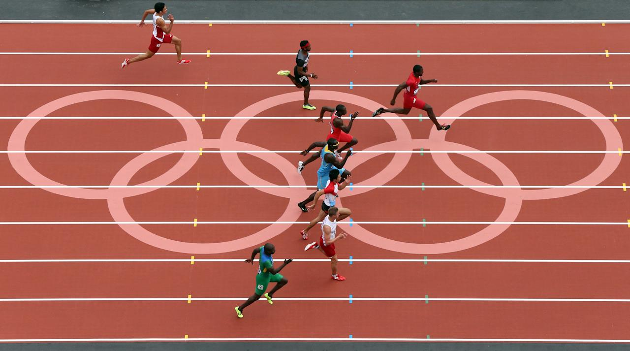 LONDON, ENGLAND - AUGUST 04:  Justin Gatlin of the United States leads as he competes in the Men's 100m Round 1 Heats on Day 8 of the London 2012 Olympic Games at Olympic Stadium on August 4, 2012 in London, England.  (Photo by Ian Walton/Getty Images)
