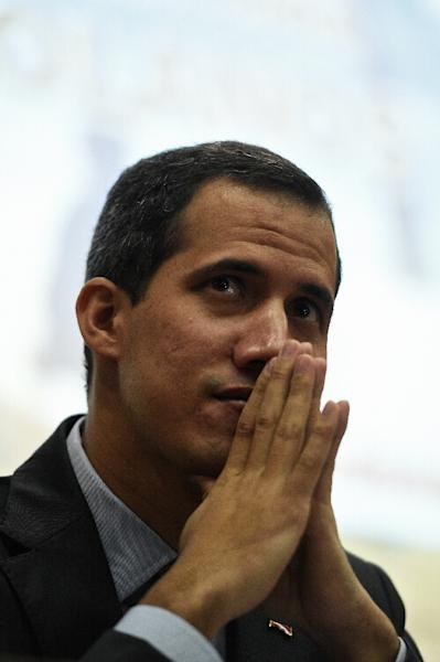 Opposition leader Juan Guaido has rejected negotiations, seeing them as a way for President Nicolas Maduro to buy time (AFP Photo/Federico PARRA)