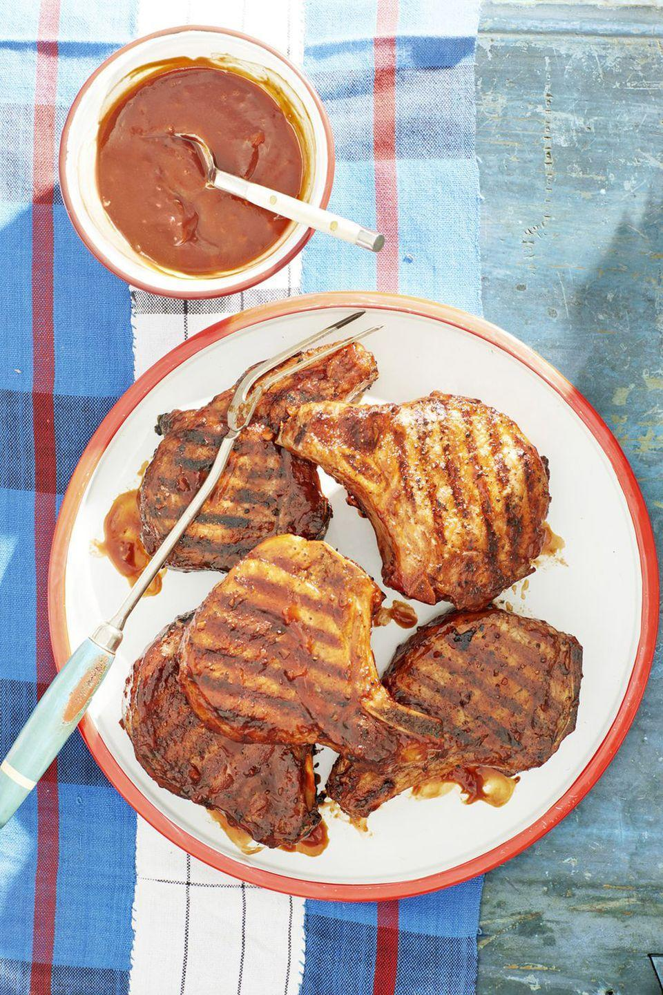 """<p>Whiskey drinkers will especially love this homemade barbecue sauce. It makes every type of grilled meat even more mouthwatering.<br></p><p><strong><a href=""""https://www.countryliving.com/food-drinks/a21347095/bourbon-bbq-glazed-pork-chops-recipe/"""" rel=""""nofollow noopener"""" target=""""_blank"""" data-ylk=""""slk:Get the recipe"""" class=""""link rapid-noclick-resp"""">Get the recipe</a></strong><strong>.</strong></p>"""