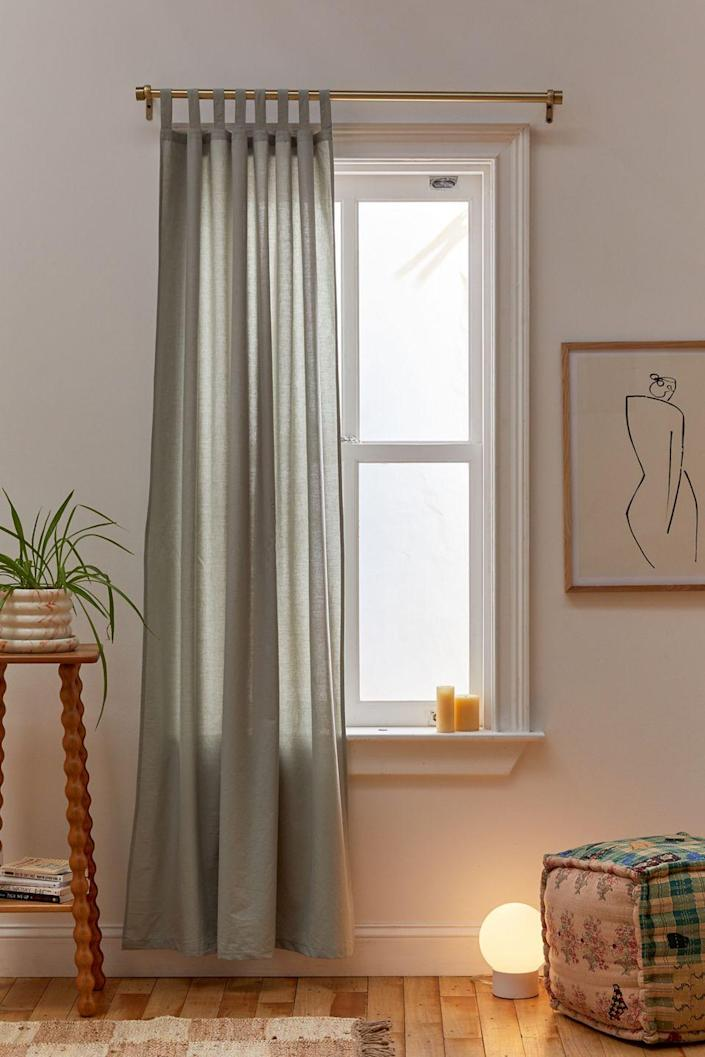 "Sometimes a touch of bohemian flair and a moody hue will do the trick. Made of a breezy cotton in a rather loose weave, these curtains won't be very effective at blocking out the light if you like to sleep in, but they make up for it by setting a relaxing mood and casual look. $39, Urban Outfitters. <a href=""https://www.urbanoutfitters.com/shop/amelia-window-panel?color=102&type=REGULAR&size=52X84&quantity=1"" rel=""nofollow noopener"" target=""_blank"" data-ylk=""slk:Get it now!"" class=""link rapid-noclick-resp"">Get it now!</a>"