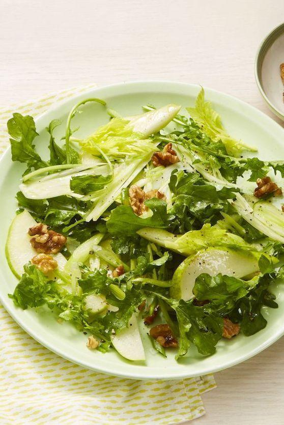 """<p>Walnuts roasted in apple pie spice give comforting fall flavor to this green salad. The lemony vinaigrette brightens everything up.</p><p><em><a href=""""https://www.womansday.com/food-recipes/food-drinks/a25652684/pear-and-walnut-salad-recipe/"""" rel=""""nofollow noopener"""" target=""""_blank"""" data-ylk=""""slk:Get the recipe from Woman's Day »"""" class=""""link rapid-noclick-resp"""">Get the recipe from Woman's Day »</a></em></p><p><strong>RELATED: </strong><a href=""""https://www.goodhousekeeping.com/food-recipes/easy/g28006549/easy-fall-salads/"""" rel=""""nofollow noopener"""" target=""""_blank"""" data-ylk=""""slk:20 Easy Fall Salads to Make the Most of Harvest Season"""" class=""""link rapid-noclick-resp"""">20 Easy Fall Salads to Make the Most of Harvest Season</a><br></p>"""