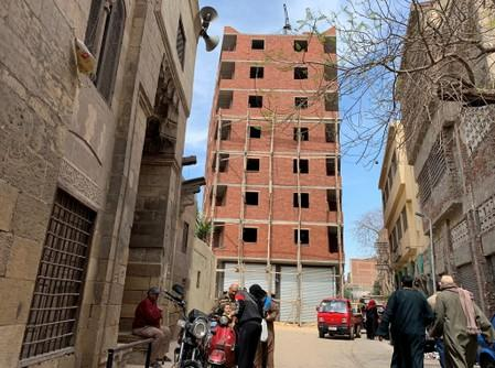 A new building is seen under construction in the historic neighbourhood of Darb al-Ahmar, in Cairo