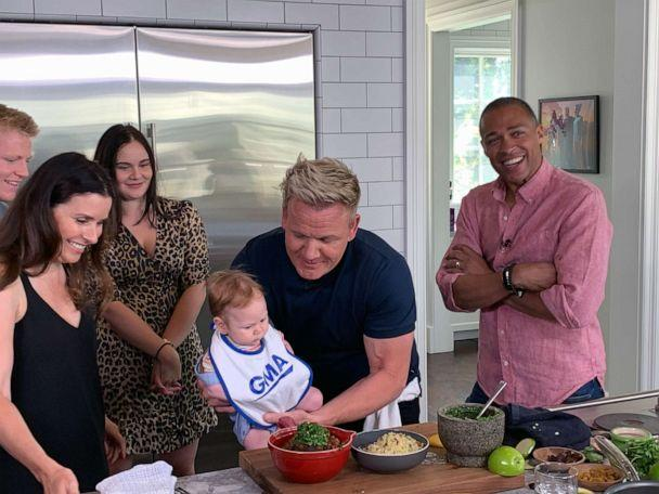 PHOTO: Chef Gordon Ramsay holds his son Oscar, alongside his wife Tana, in his kitchen after preparing a Moroccan-inspired dish. (ABC News)