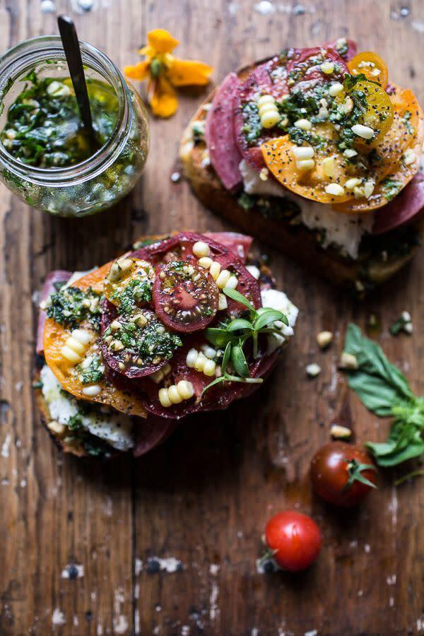 """<p><strong>Get the <a href=""""http://www.halfbakedharvest.com/tomato-salami-and-chunky-arugula-basil-pesto-bruschetta/"""" rel=""""nofollow noopener"""" target=""""_blank"""" data-ylk=""""slk:Tomato, Salami and Chunky Arugula-Basil Pesto Bruschetta recipe"""" class=""""link rapid-noclick-resp"""">Tomato, Salami and Chunky Arugula-Basil Pesto Bruschetta recipe</a>&nbsp;from Half Baked Harvest</strong></p>"""