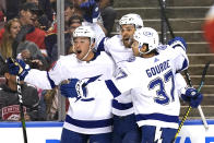 Tampa Bay Lightning left wing Ross Colton, left, celebrates with Yanni Gourde (37) after scoring a goal against the Florida Panthers during the first period in Game 5 of an NHL hockey Stanley Cup first-round playoff series, Monday, May 24, 2021, in Sunrise, Fla. (AP Photo/Lynne Sladky)