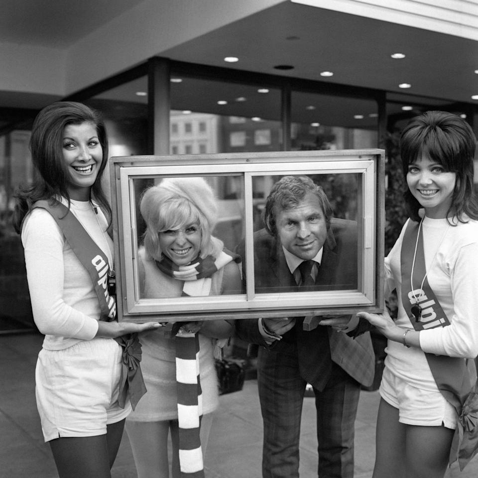 Actress Barbara Windsor and Bobby Moore the West Ham and England football captain, are framed in a section of double glazing when they were guest celebrities at a firm's double glazing annual sales convention. The hostesses in football strip are Lyn Marshall (left) and Glenys O'Brien.