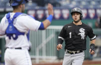 Chicago White Sox's Nick Madrigal runs home to score past Kansas City Royals catcher Sebastian Rivero on a double by Yoan Moncada during the first inning of a baseball game Saturday, May 8, 2021, in Kansas City, Mo. (AP Photo/Charlie Riedel)