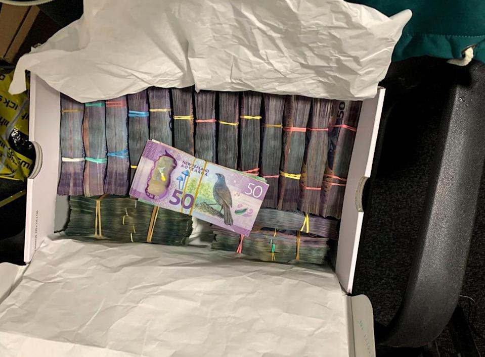 A box containing a large amounts of cash is seen after being discovered during a police raid as part of Operation Trojan.