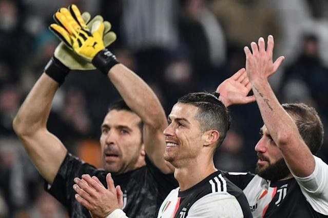 Juventus goalkeeper Gianluigi Buffon and striker Cristiano Ronaldo both got on the scoresheet (AFP Photo/Marco Bertorello)