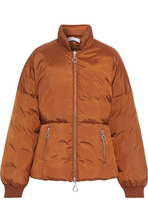 """<p>Rodebjer Guccia Quilted Shell Down Coat, $258 (from $575), <a href=""""https://rstyle.me/+gNjATClvlVFxngZCagq5wA"""" rel=""""nofollow noopener"""" target=""""_blank"""" data-ylk=""""slk:available here"""" class=""""link rapid-noclick-resp"""">available here</a>. </p>"""